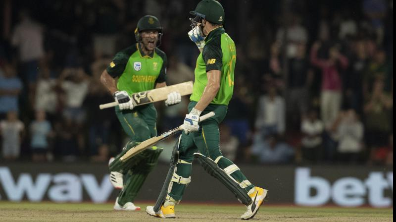South Africa's batsman Janneman Malan (right) is congratulated by his teammate David Miller after the former completed his century during the second One Day International against Australia at Managing Oval in Bloemfontein on Wednesday. AP Photo