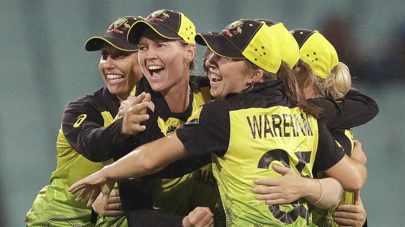 Jubilant Australian cricketers celebrate their semi-final victory over South Africa in the T20 World Cup in Sydney on Thursday. AP Photo