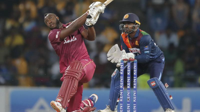 West Indies' batsman Andre Russell hammers a delivery for maximum during the second and final T20 International in Pallekele, Sri Lanka, on Friday. AP Photo