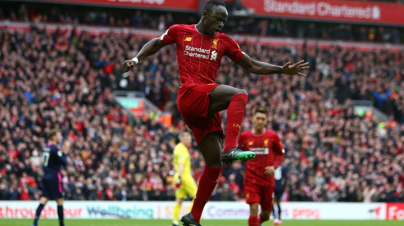 Liverpool's Senegalese striker Sadio Mane celebrates scoring his team's second goal during the English Premier League match against Bournemouth at Anfield in Liverpool, north west England, on Saturday. AFP Photo