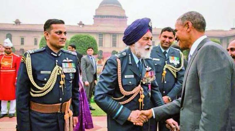 US President Barack Obama greets Marshal of the Indian Air Force Arjan Singh in the forecourt of Rashtrapati Bhavan at the Republic Day celebrations in January 2015. The Marshal is accompanied by his staff officer, Wing Commander Mohan Rana.