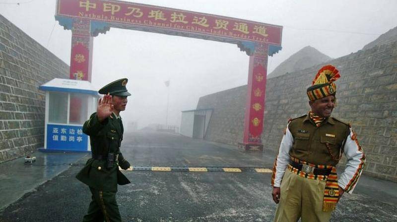A Chinese soldier stands next to an Indian soldier at the Nathu La border crossing between India and China (AFP file photo)