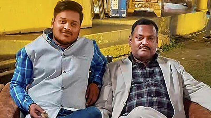 Undated photo shows Vikas Dubey with his close aide Amar Dubey (L) who was killed in an encounter recently. ( PTI)