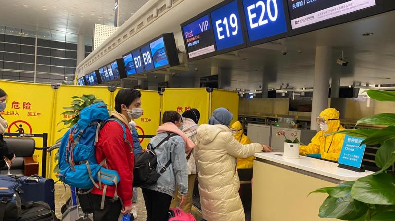 Indonesian nationals check-in at Tianhe airport in Wuhan, China's Hubei province, before boarding a flight and being evacuated to Indonesia. AFP photo