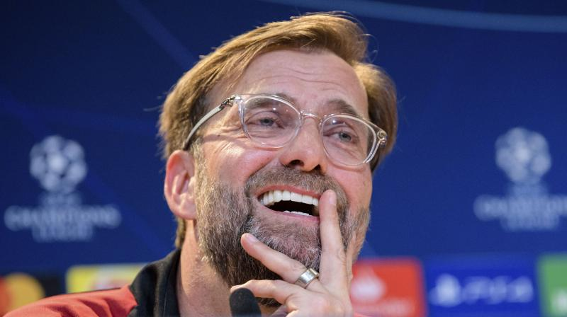 Klopp's side have a two-point lead over Pep Guardiola's City but have played a game more. (Photo: AFP)