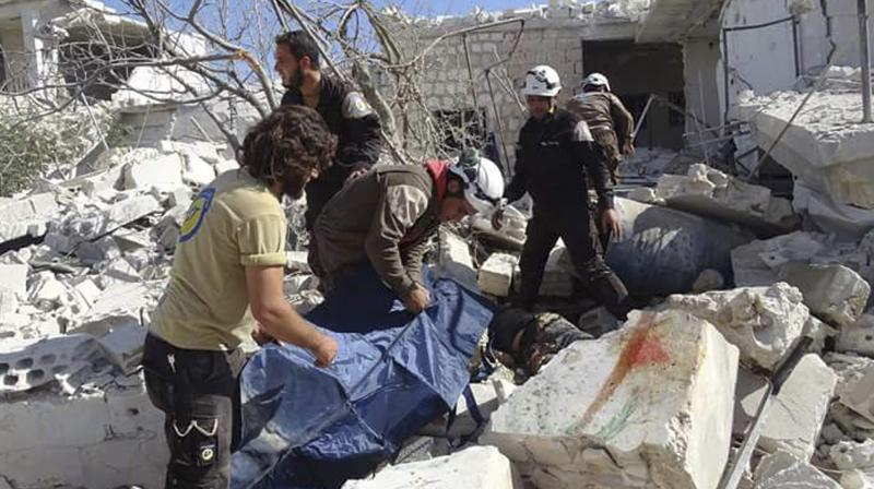 'The toll increased after removing the debris in a long day of rescue operation,' the Syrian Observatory for Human Rights said, adding the strikes hit 'residential buildings.' (Photo: AFP)