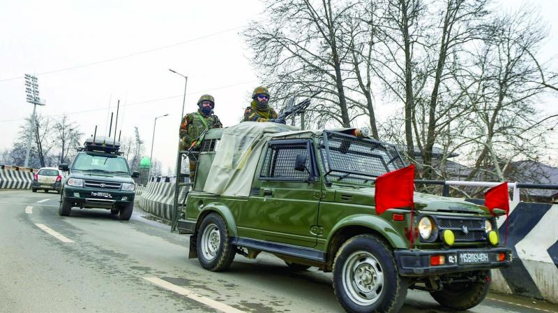 A security vehicle escort the cavalcade of ambassadors in Srinagar on Thursday. (Photo: PTI)