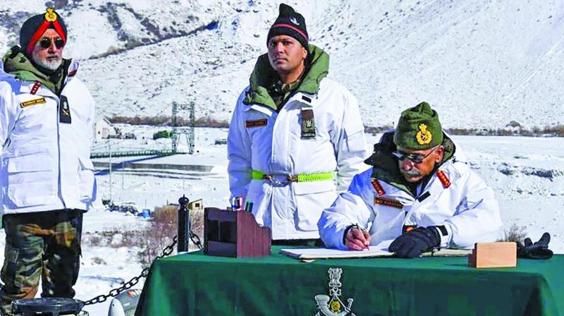Army Chief General Manoj Mukund Naravane writes in the visitors register after paying homage at the war memorial during his visit to the army base camp in Siachen. (Photo: PTI)