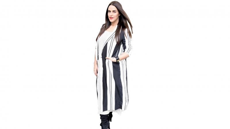 Mum-to-be, Neha Dhupia is mostly seen wearing straight cut dresses, layered with long jackets and shrugs.