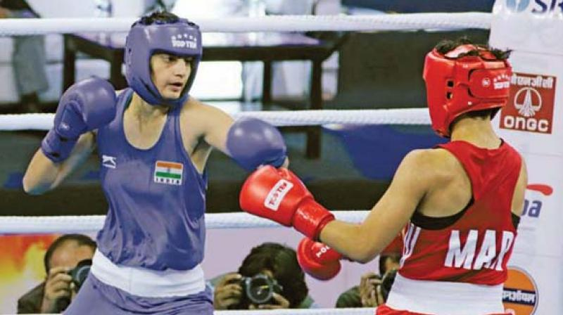 Sonia Lather (left) in action against Morocco's Toujani Doaa in the 10th Aiba Women's World Boxing Championship in New Delhi.