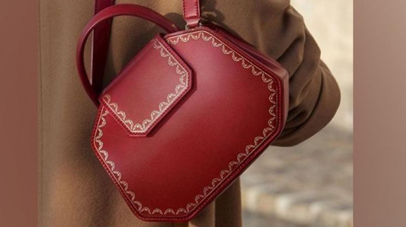 The handbag unveiled by Cartier, which is inspired by its iconic jewellery boxes is ideal for everyone with a unique touch of the post-Christmas blues. (Photo: ANI)