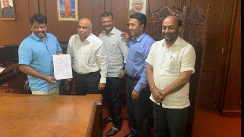 Legislators Manohar Ajgaonkar and Dipak Pawaskar gave a letter to merge the MGP legislature party with the BJP to officiating Goa Assembly Speaker Michael Lobo at 1:45 am. (Photo: ANI)