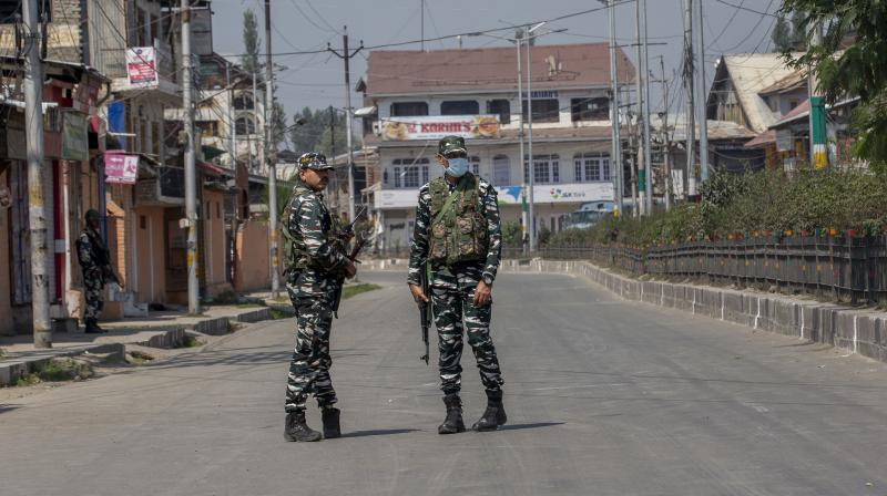 Paramilitary soldiers patrol a road near the residence of top separatist leader Syed Ali Shah Geelani in Srinagar, Kashmir, Friday, Sept. 3, 2021. (AP/ Dar Yasin)
