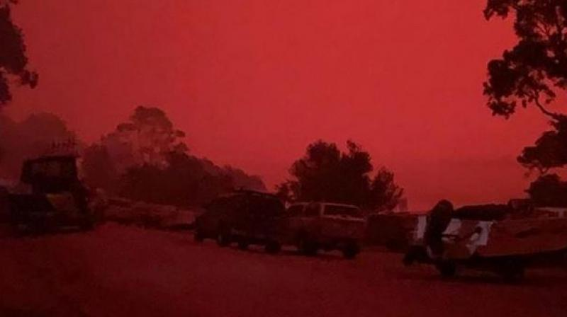 With the coastal town of Mallacoota ringed by wildfires and the main road in and out of town cut off, residents and holidaymakers were forced to head to the local gymnasium or waterfront as embers swept through the town. (Photo: Social Media)