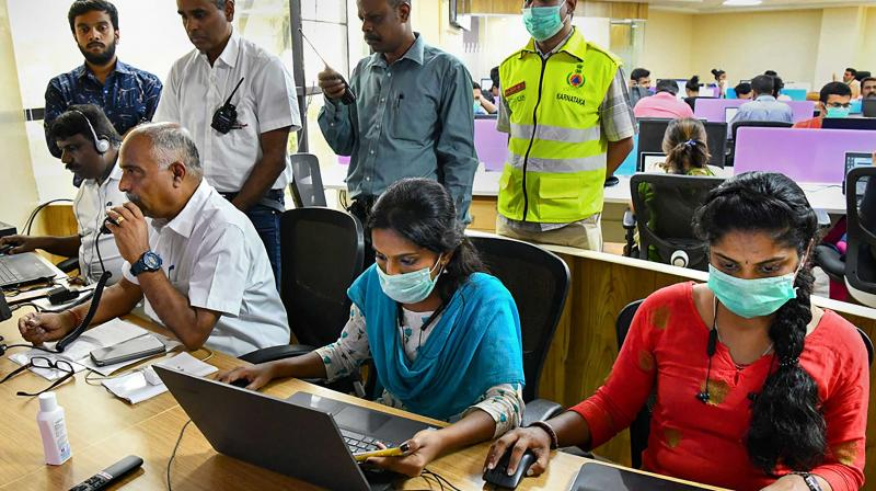 Officials work in the Karnataka Chief Minister's Covid-19 War Room at DIPR Building in Bangalore (PTI)