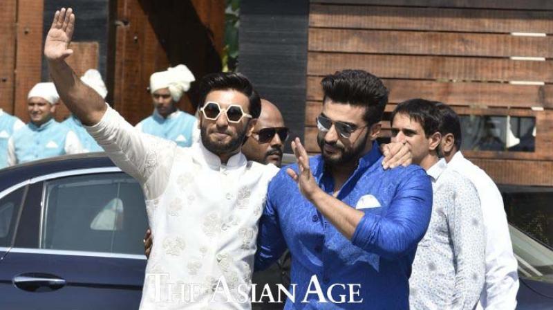 Ranveer Singh and Arjun Kapoor at Sonam Kapoor's wedding.