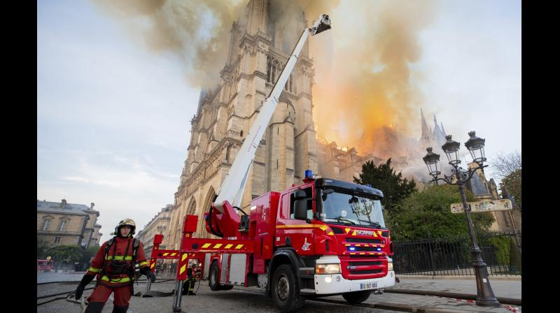 Paris Fire Brigade shows fire fighters working at the burning Notre Dame cathedral. (Photo:AP)
