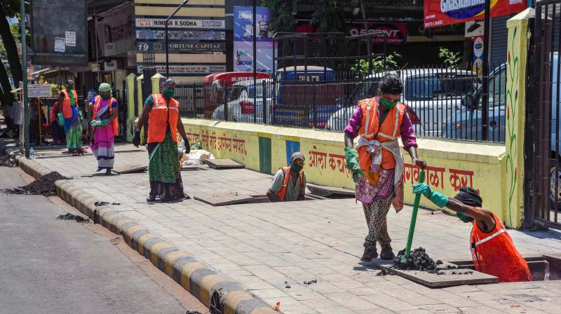 Workers clean drains at Vashi ahead of pre-monsoon season, during the ongoing COVID-19 nationwide lockdown, in Navi Mumbai. (PTI)