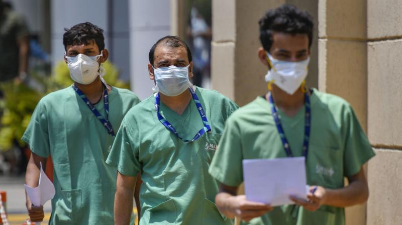 Health workers seen inside the premises of Max Hospital, during the nationwide lockdown to curb the spread of coronavirus, in New Delhi. (PTI)
