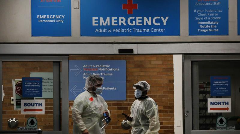 Medical workers take in patients outside a special coronavirus area at Maimonides Medical Center in the Borough Park neighborhood of the Brooklyn borough of New York City. (AFP)
