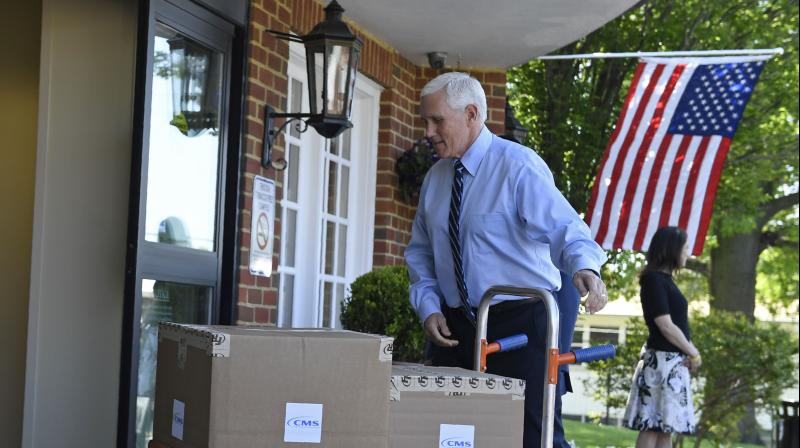 US vice president Mike Pence unloads boxes of PPE. (AP)