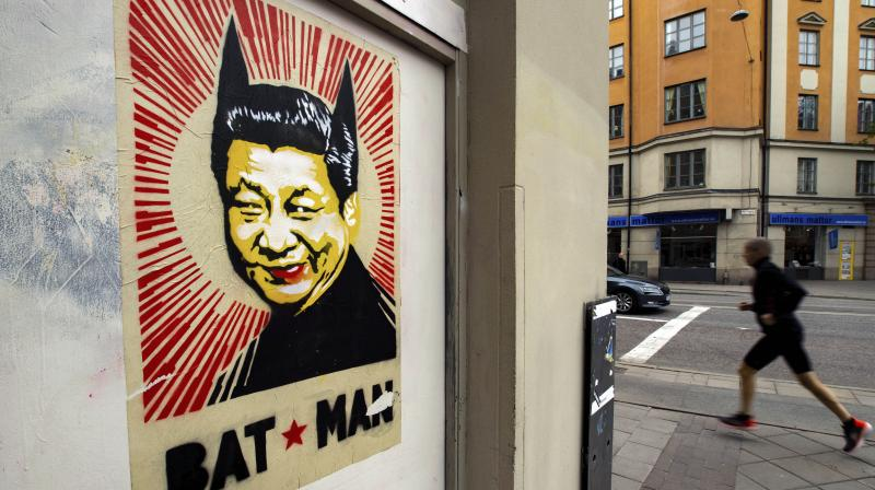 A poster depicts Chinese president Xi Jinping with two pointed ears underlined by the words