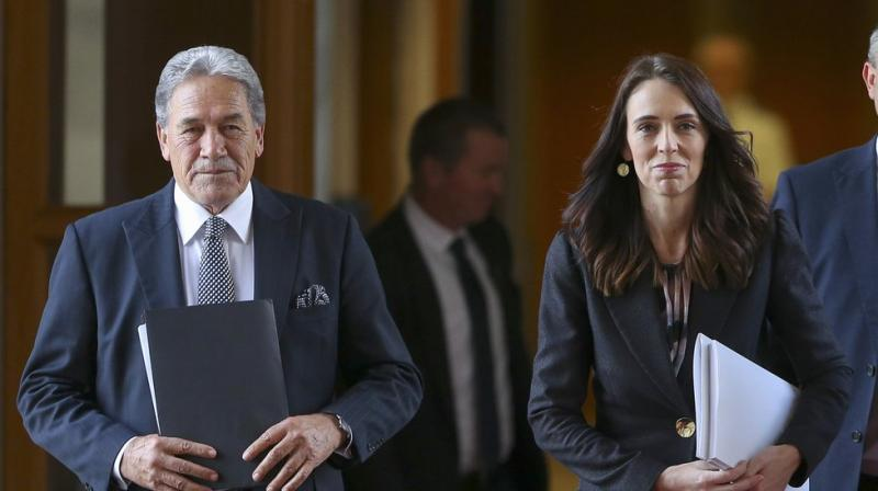 New Zealand prime minister Jacinda Ardern, right, walks with deputy prime minister Winston Peters to the house for the budget delivery speech at Parliament in Wellington. (AP)