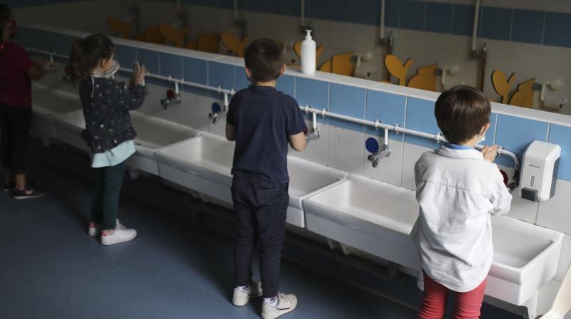 Children wash their hands at the Saint-Tronc Castelroc primary school in Marseille, southern France. (AP)