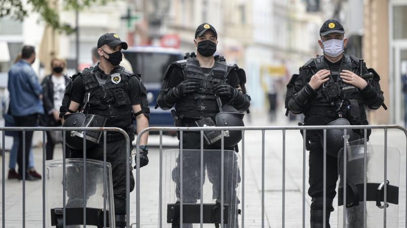 Bosnian riot policemen stand outside the Sacred Heart Cathedral in Sarajevo, Bosnia, ahead of the commemoration Mass for Croatian pro-Nazis killed at the end of World War II. (AP)