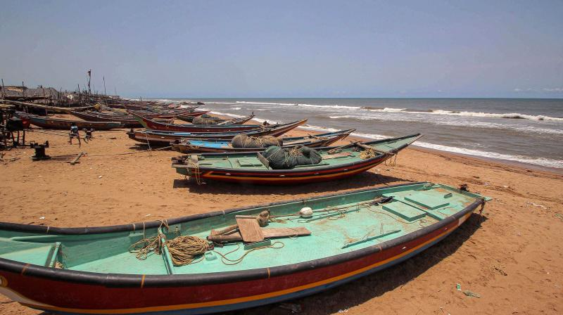Fishing boats anchored at the Puri beach after authorities warned fishermen not to venture into the sea in the view of Cyclone Amphan, at Konark in Puri district. (PTI)