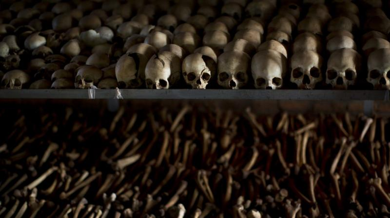 The skulls and bones of some of those who were slaughtered as they sought refuge inside the church are laid out as a memorial to the thousands who were killed in and around the Catholic church during the 1994 genocide in Ntarama, Rwanda. (AP)