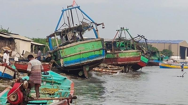 Damaged fishermen boats are seen following thunderstorm and rainfall due to Cyclone Amphan. (PTI)