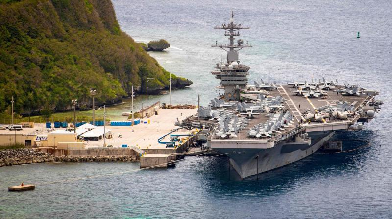Aircraft carrier USS Theodore Roosevelt (CVN 71)as it is moored pier side at Naval Base Guam. (AFP)