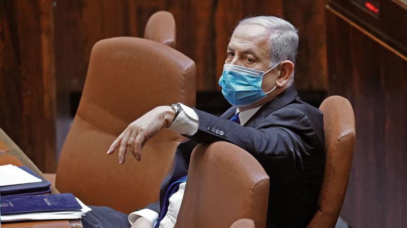 A handout picture released by the Israeli Knesset (parliament) spokesperson's office on May 17, 2020, shows Israeli Prime Minister Benjamin Netanyahu attending a parliamentary session in Jerusalem ahead of the swearing-in ceremony of the new government. (Via AFP)