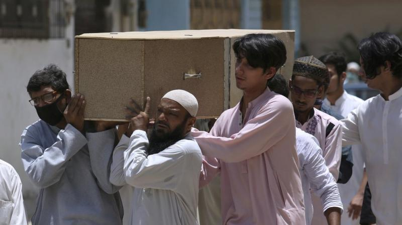 People carry the casket of a victim of Friday's plane crash, for funeral prayers in Karachi, Pakistan, Saturday, May 23, 2020. (AP)