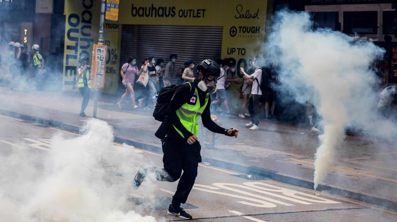 Police fire tear gas on protesters during a planned protests against a proposal to enact a new security legislation in Hong Kong on May 24, 2020. (AFP)