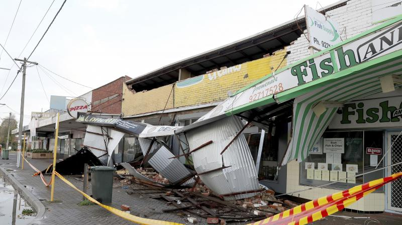 Debris falls from a row of damaged shops in Perth, Australia, Monday, May 25, 2020. (AP)