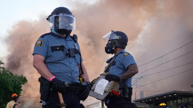 Police face off with protestors after several fires were started on May 28, 2020 in St. Paul, Minnesota. (AFP)