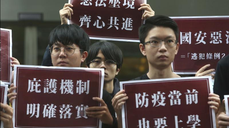 Hong Kong students and Taiwanese supporters hold slogan reading