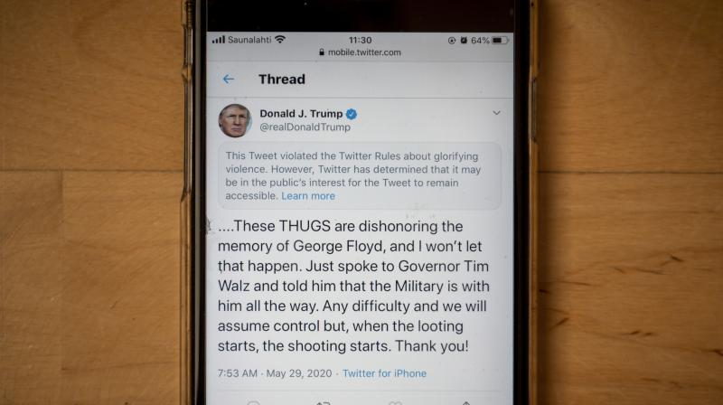The twitter page of US President Donald Trump's is displayed on a mobile phone. (AFP)