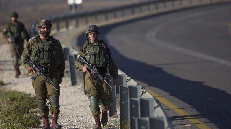 Israeli soldiers patrol roads. (AP)