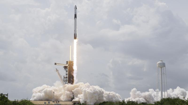 A SpaceX Falcon 9, with NASA astronauts Doug Hurley and Robert Behnken in the Dragon crew capsule, lifts off from Pad 39-A at the Kennedy Space Center in Cape Canaveral, Fla., Saturday, May 30, 2020. (AP)