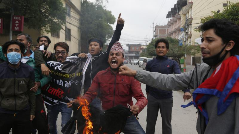 Nepalese students shout slogans during a protest against the Indian government inaugurating a new road through a disputed territory between India and Nepal, in Kathmandu, Nepal.(AP)