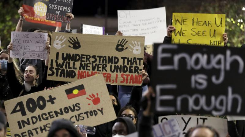 Protestors gather in Sydney to support the cause of U.S. protests over the death of George Floyd. (AP)