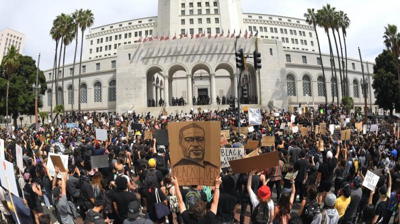 Demonstrators stand in front of Los Angeles City Hall during a protest over the death of George Floyd. (AP)