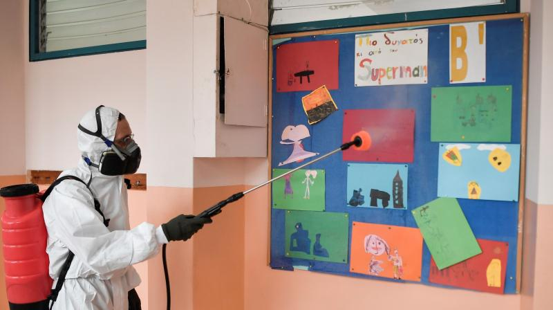 An employee disinfects and cleans the classroom of a kindergarten in China. (AFP)
