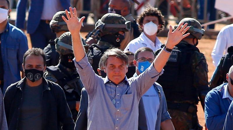 Brazilian President Jair Bolsonaro (C). (AFP)