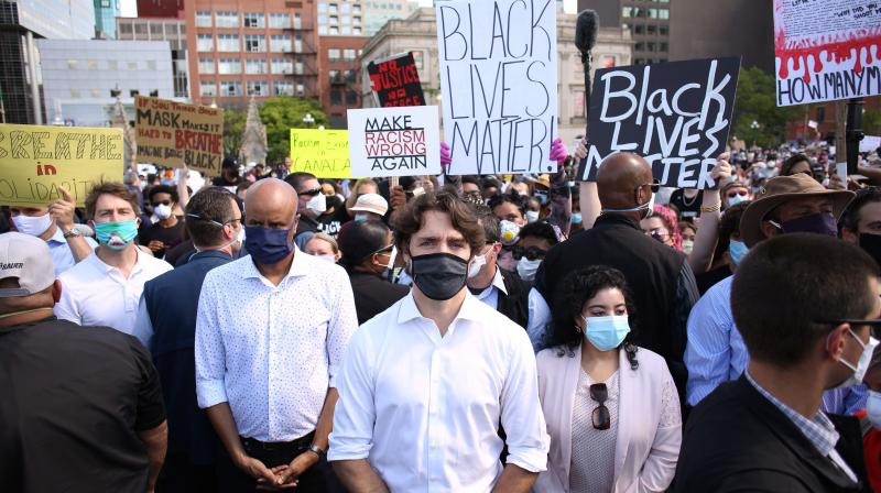 Canadadian Prime Minister Justin Trudeau (C) takes part in a Black Lives Matter protest on Parliament Hill.(AFP)