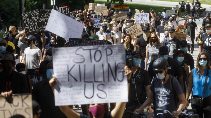 Protestors march during an anti-racism march on June 6, 2020 in Toronto, Canada. (AFP)