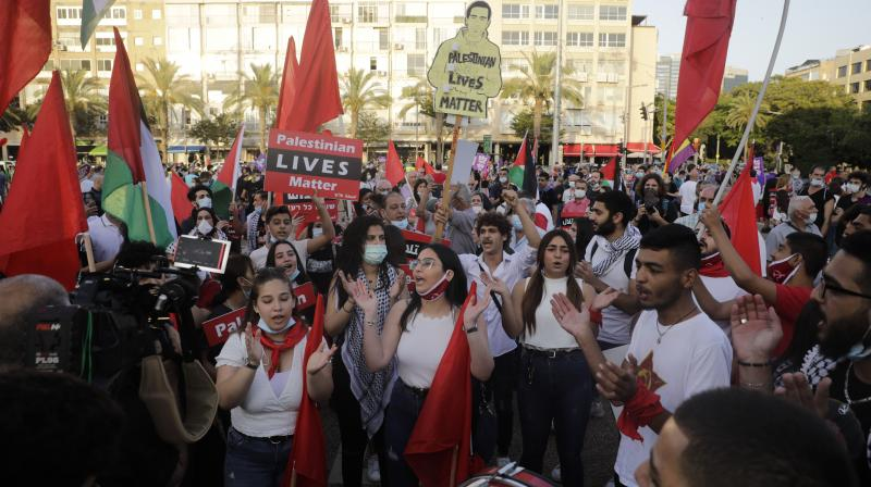 People chant during a rally against Israel plans to annex parts of the West Bank, in Tel Aviv. (AP)